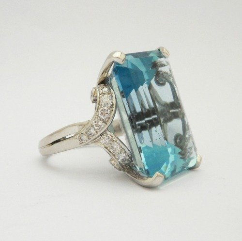 Anthea AG - A fine aquamarine and diamond ring with a large central aquamarine circa 1940s 8500 OIAAF