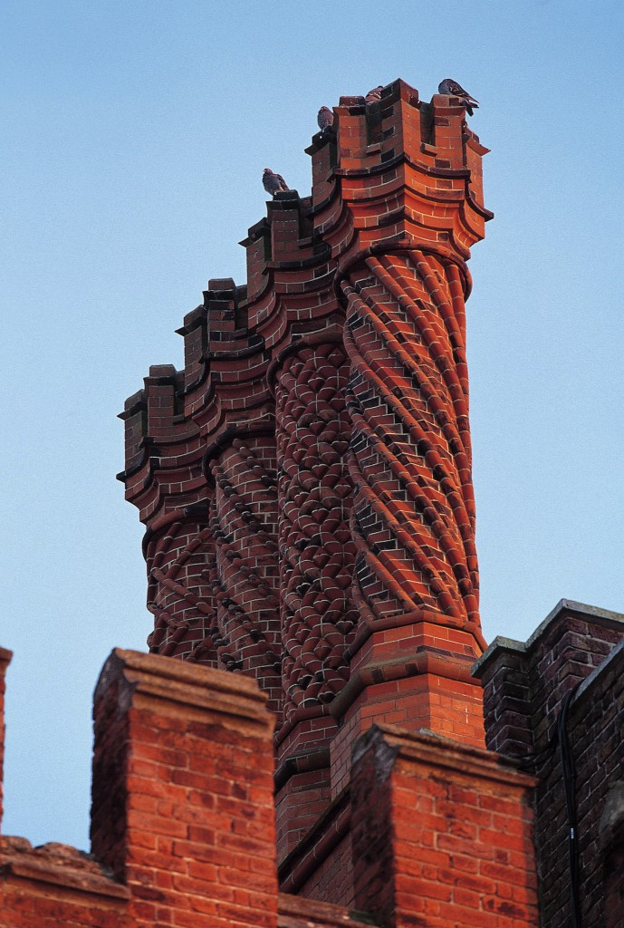 The famous Tudor 'Swizzle Stick' chimney pots stand out on the rooftops of Hampton Court Palace.  Credit: Historic Royal Palaces/newsteam.co.uk