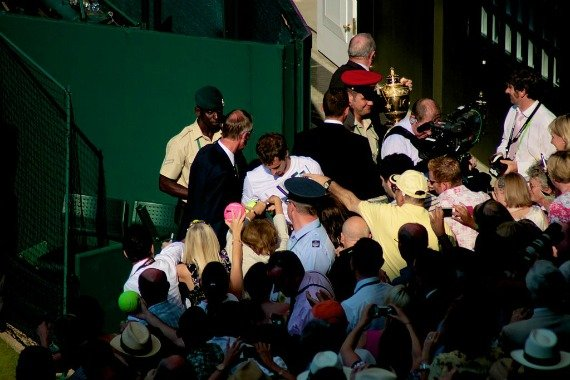 A popular man. Murray signing autographs after his 2013 win.