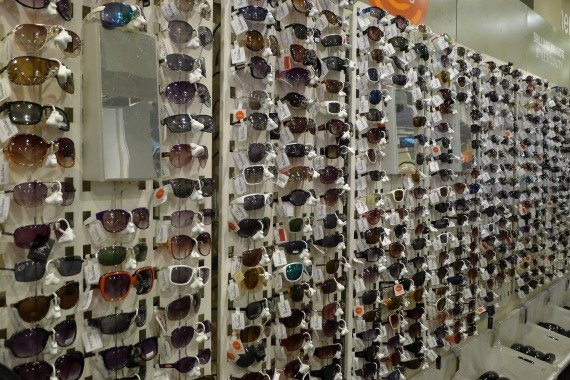 A whole wall of sunglasses at TK Maxx in London
