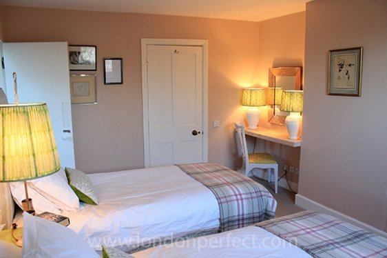 Charming second bedroom with two twin beds and en suite bathroom