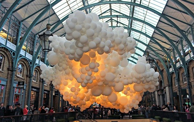 Crowds admire the installation of 100,000 white balloons by artist Charles Pétillon