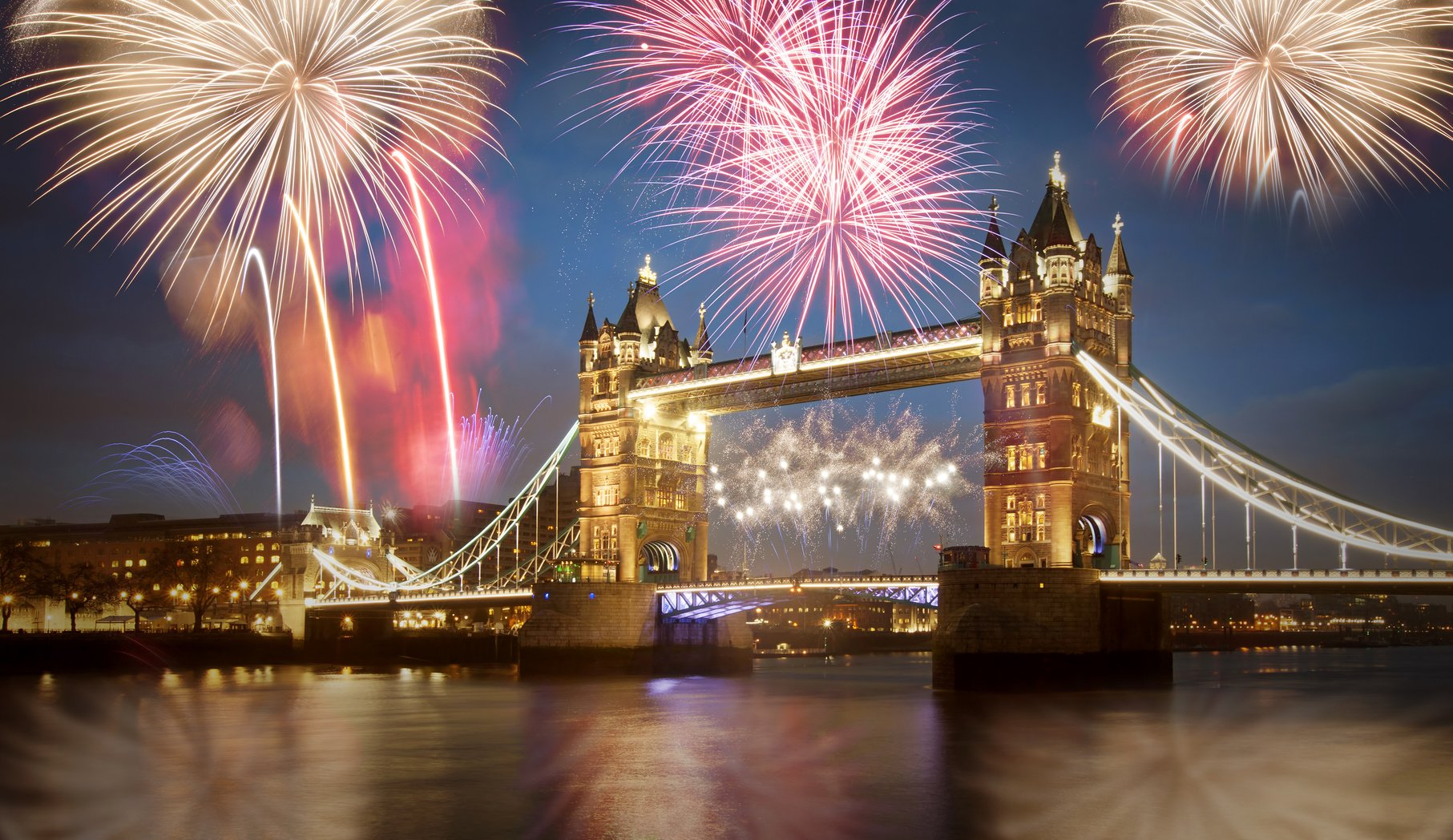 Tower bridge with firework, celebration of the New Year in London, UK.