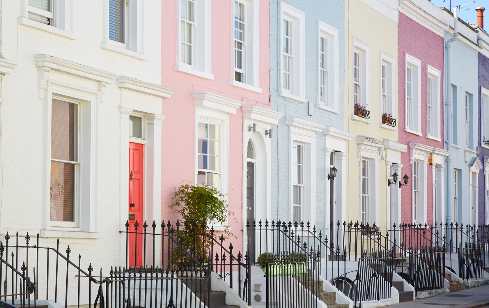 Row of pastel coloured houses in Notting Hill