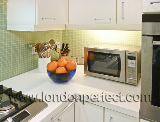 Green Mosaic Tile Splashback Microwave And Separate Convection Oven