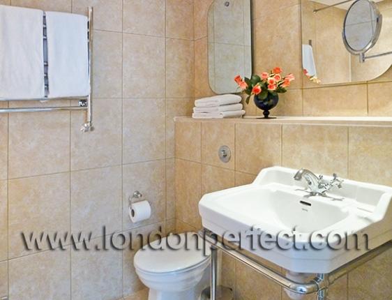 En Suite Bathroom Has Sink Toilet And Bathtub Shower Combination