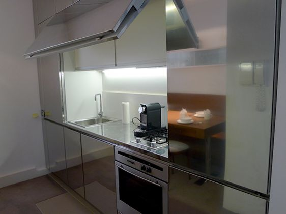 Modern stainless steel kitchen and dining area