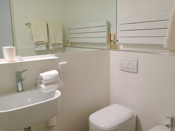 Bathroom with shower, sink, toilet and bidet