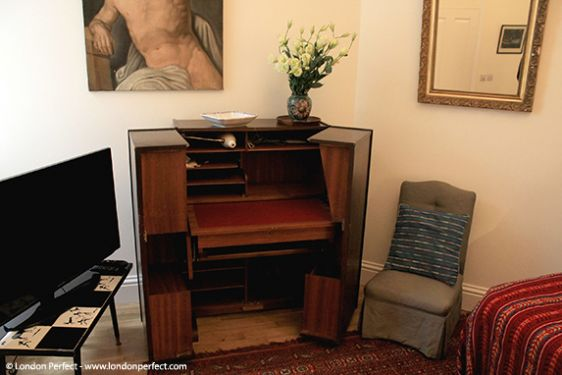 Open the writing desk in the TV room