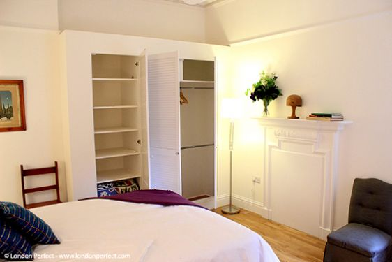 Spacious bedroom with queen bed and large closets