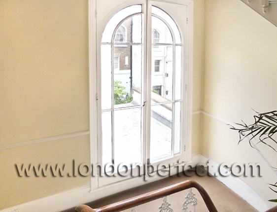 Large Arched Window On Stairwell