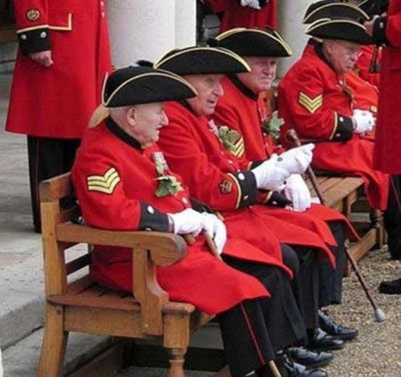 Chelsea Pensioners in their brilliant red uniforms