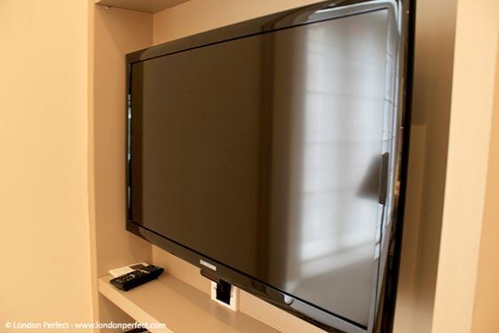 Flat-screen TV in living room with DVD player