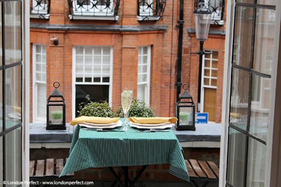 Balcony in our Palmerston rental with bistro table and chairs