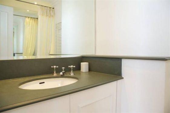 En suite bathroom with bathtub-shower, sink and toilet