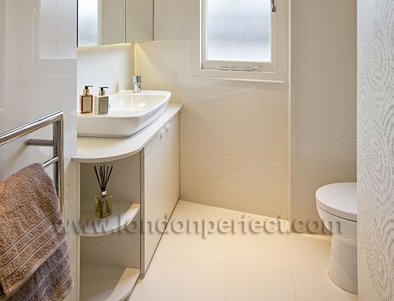Beautifully remodeled bathroom with shower, toilet and sink
