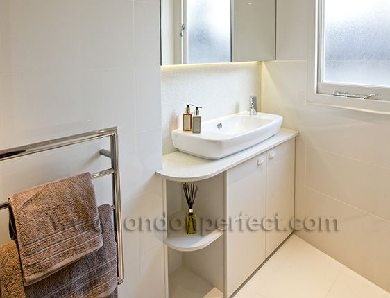 Stylish porcelain sink is complemented by modern fixtures