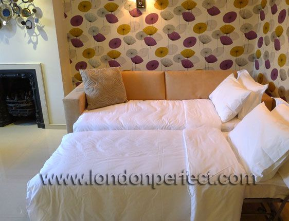 Sofa made up as two singles in the Mayfair vacation rental offered by London Perfect