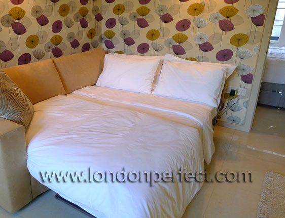 Sofa made up as dual-queen bed in the Mayfair vacation rental offered by London Perfect