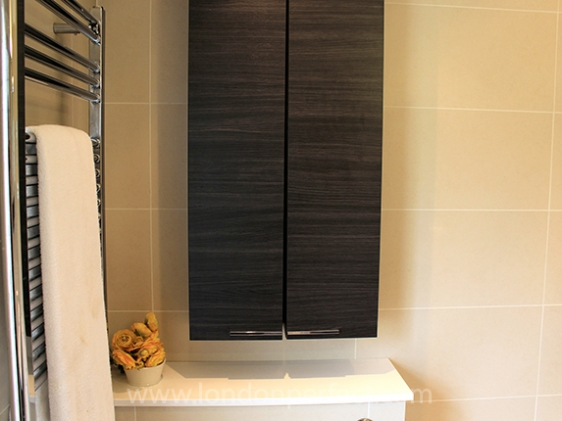 Heated towel rail and plenty of storage in bathroom