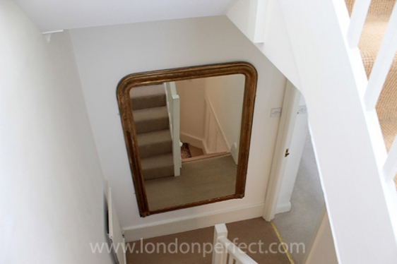 Looking down the central staircase in London vacation home