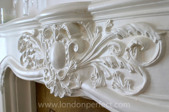 Beautiful details on the fireplace mantel in first bedroom