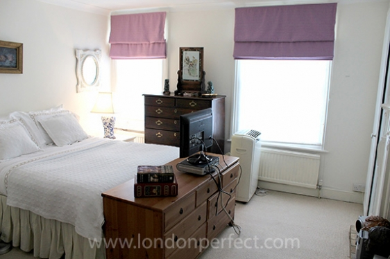 Spacious first bedroom with portable air conditioning