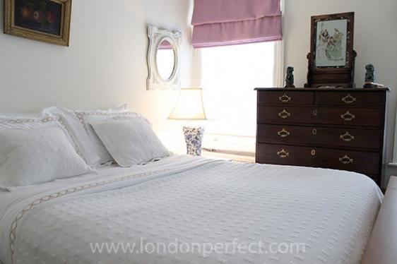 First bedroom with queen bed and en suite bathroom
