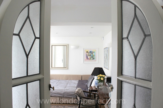 Open the glass-panelled doors and step into the third bedroom