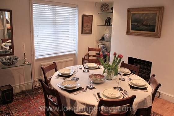 Dining room with large round dining table that seats six