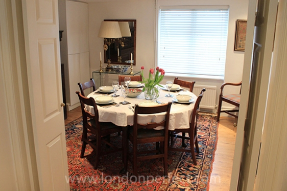 View from kitchen into dining room with large round table
