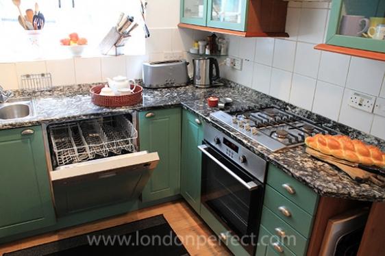 Dishwasher hidden behind cabinet in the kitchen