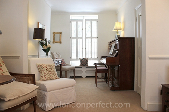 Charming living room nook with piano and sitting area
