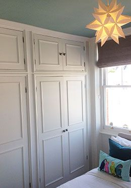 Floor-to-ceiling wardrobe in the starlit bedroom of the Austen vacation rental offered by London Perfect