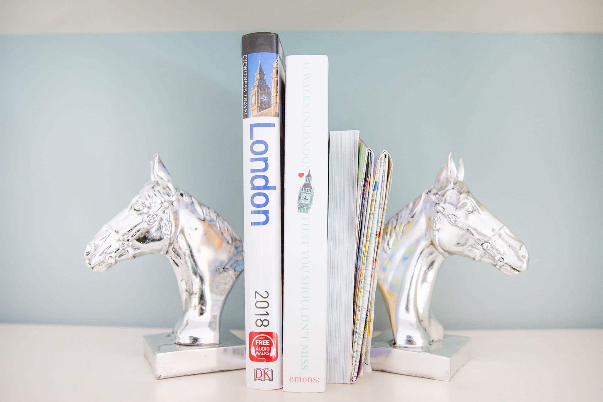 Bookshelf with silver equine bookends in the Gordon vacation rental offered by London Perfect