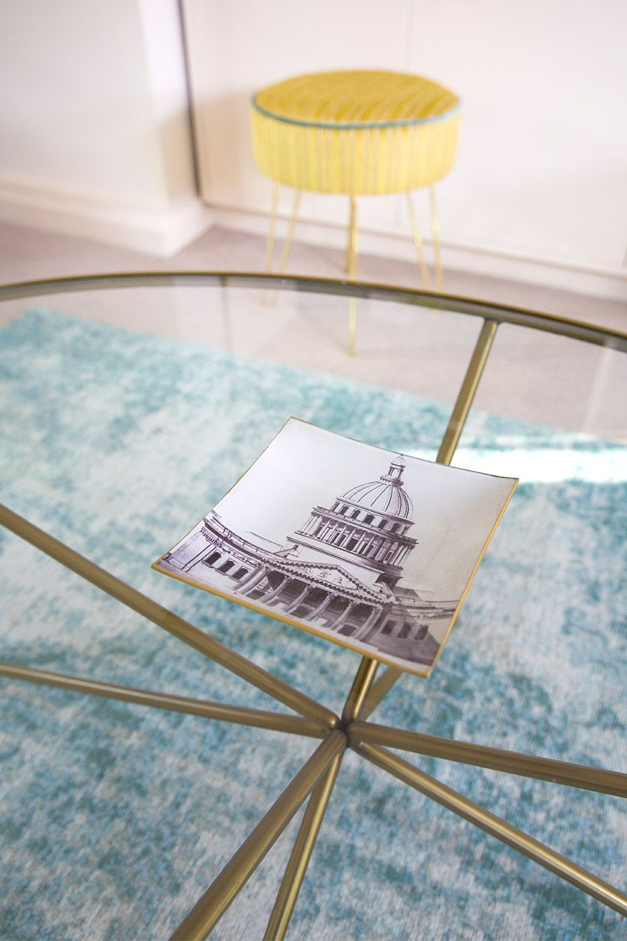 Elegant glass coffee table in the Gordon vacation rental offered by London Perfect