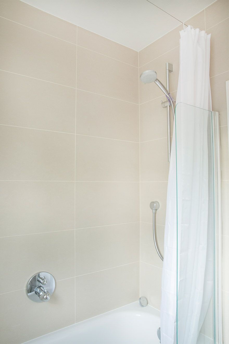 Bath with shower fixture in the Gordon vacation rental offered by London Perfect