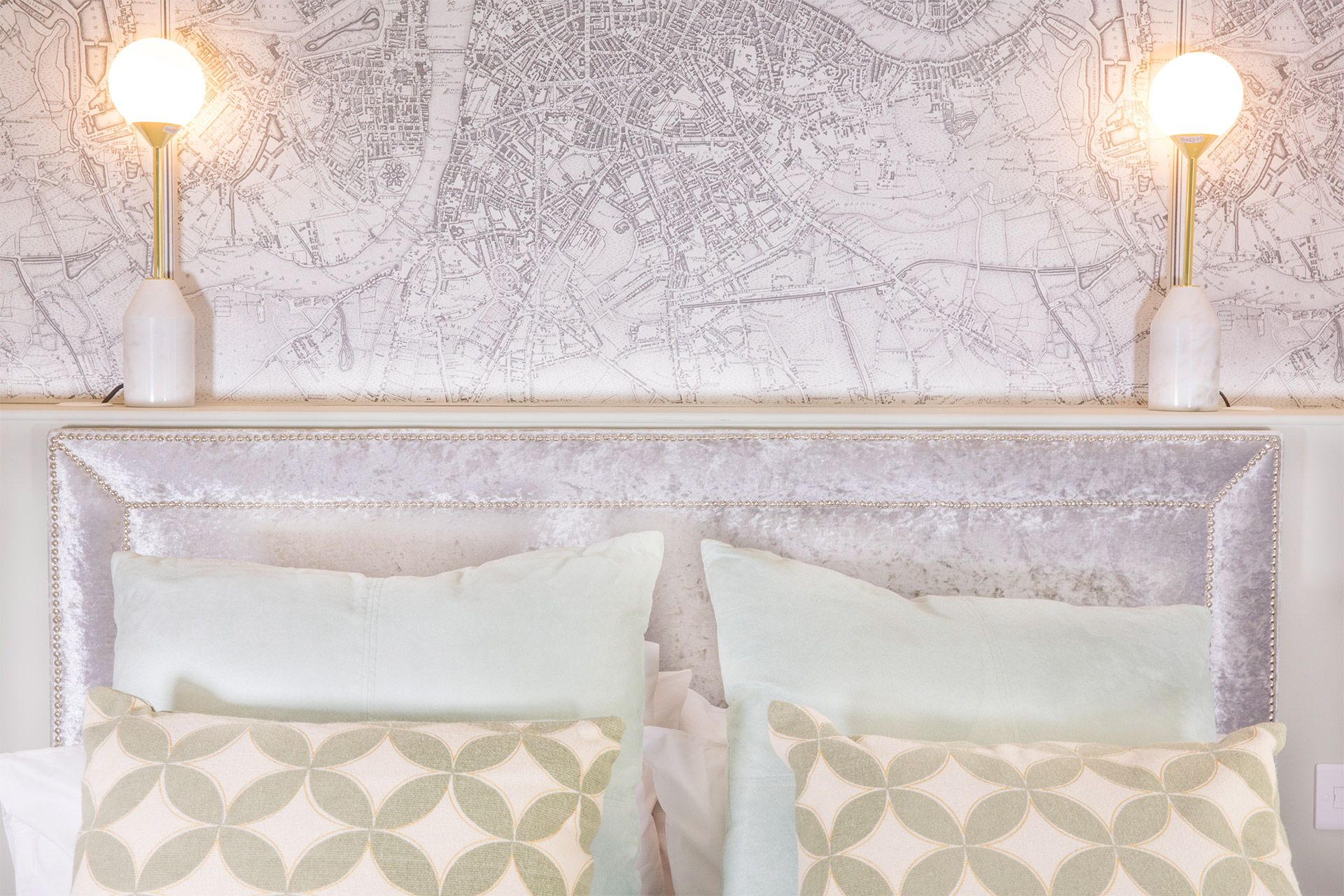 A London map above the bed in the Gordon vacation rental offered by London Perfect