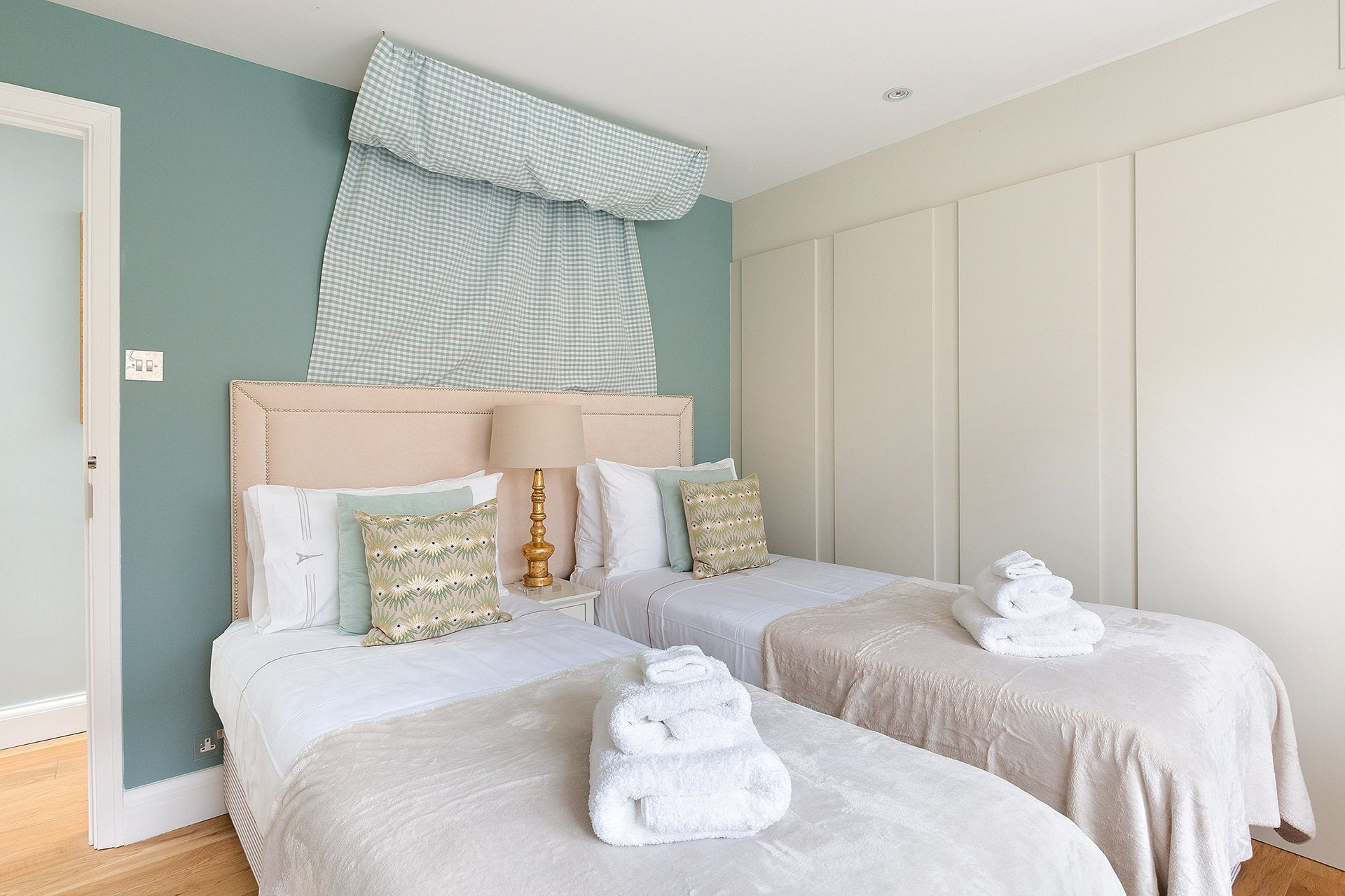 Blue pillows in first bedroom of the Eldon vacation rental offered by London Perfect
