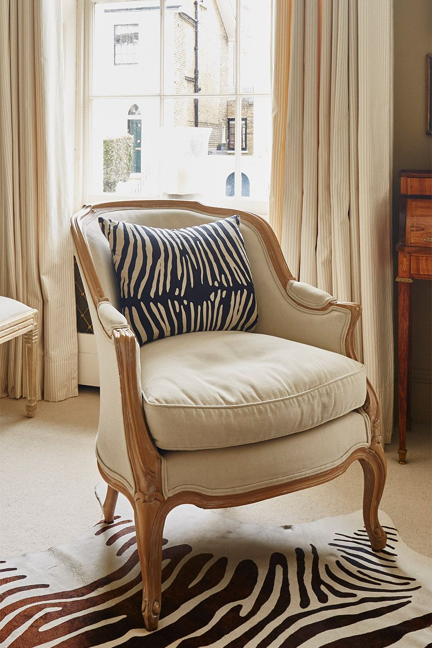 Elegant chair in the living room of the Victoria rental offered by London Perfect
