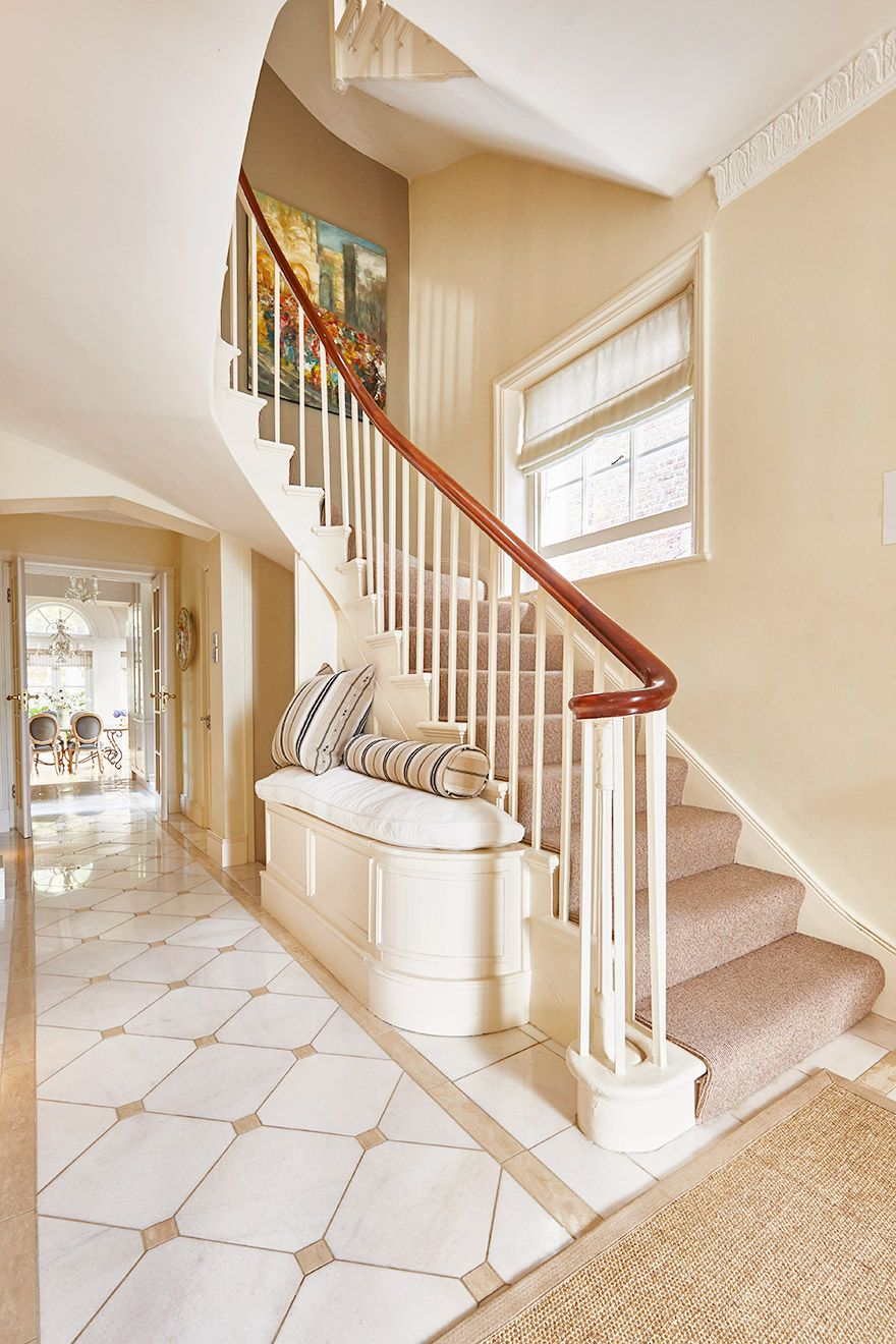 Carpeted staircase in the Victoria vacation rental offered by London Perfect