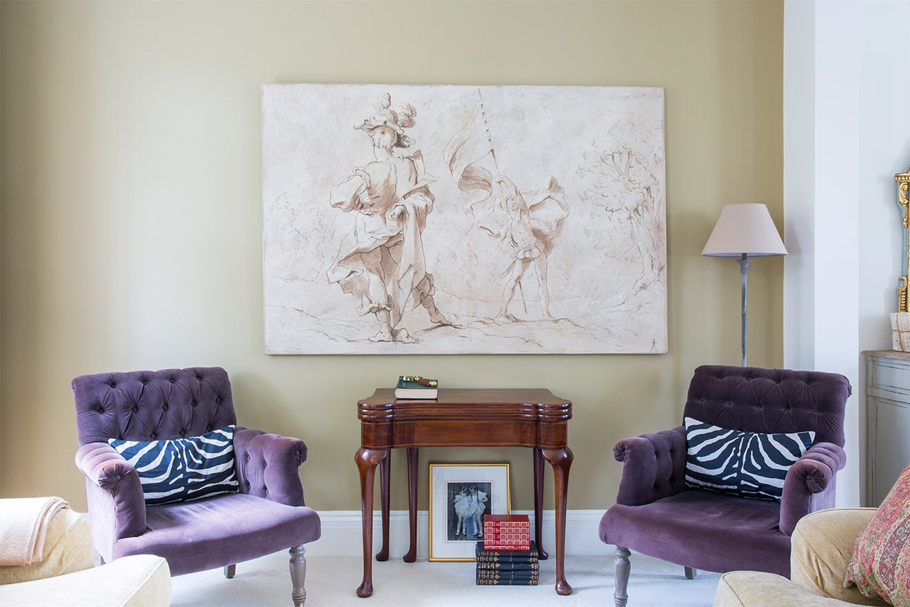 Elegant armchairs in the living room of the Victoria rental offered by London Perfect
