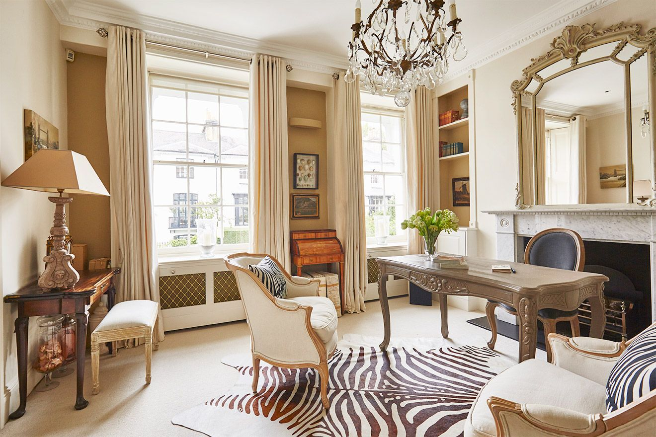 Large windows in the living room of the Victoria rental offered by London Perfect