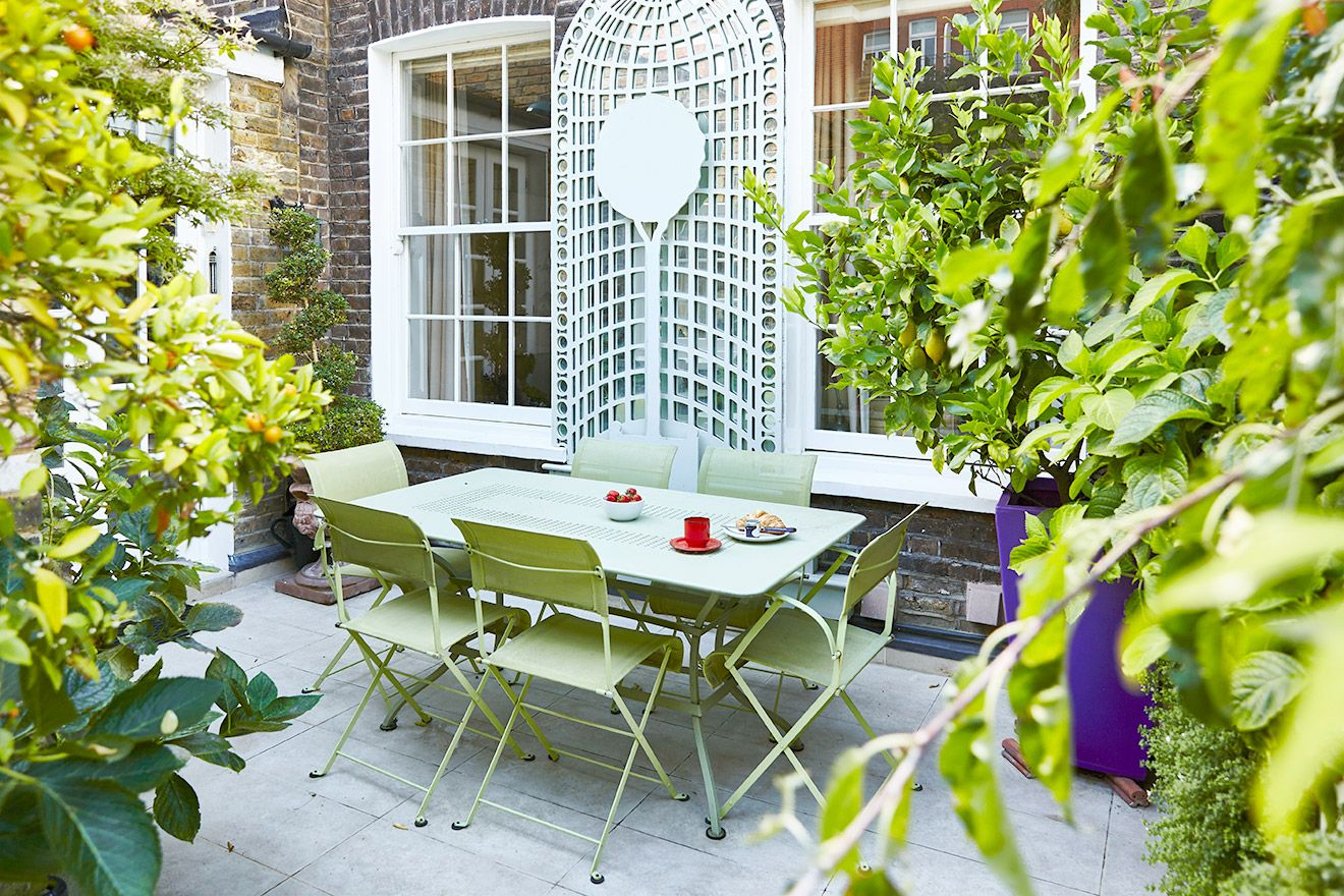 Dine al fresco on the patio of the Victoria rental offered by London Perfect