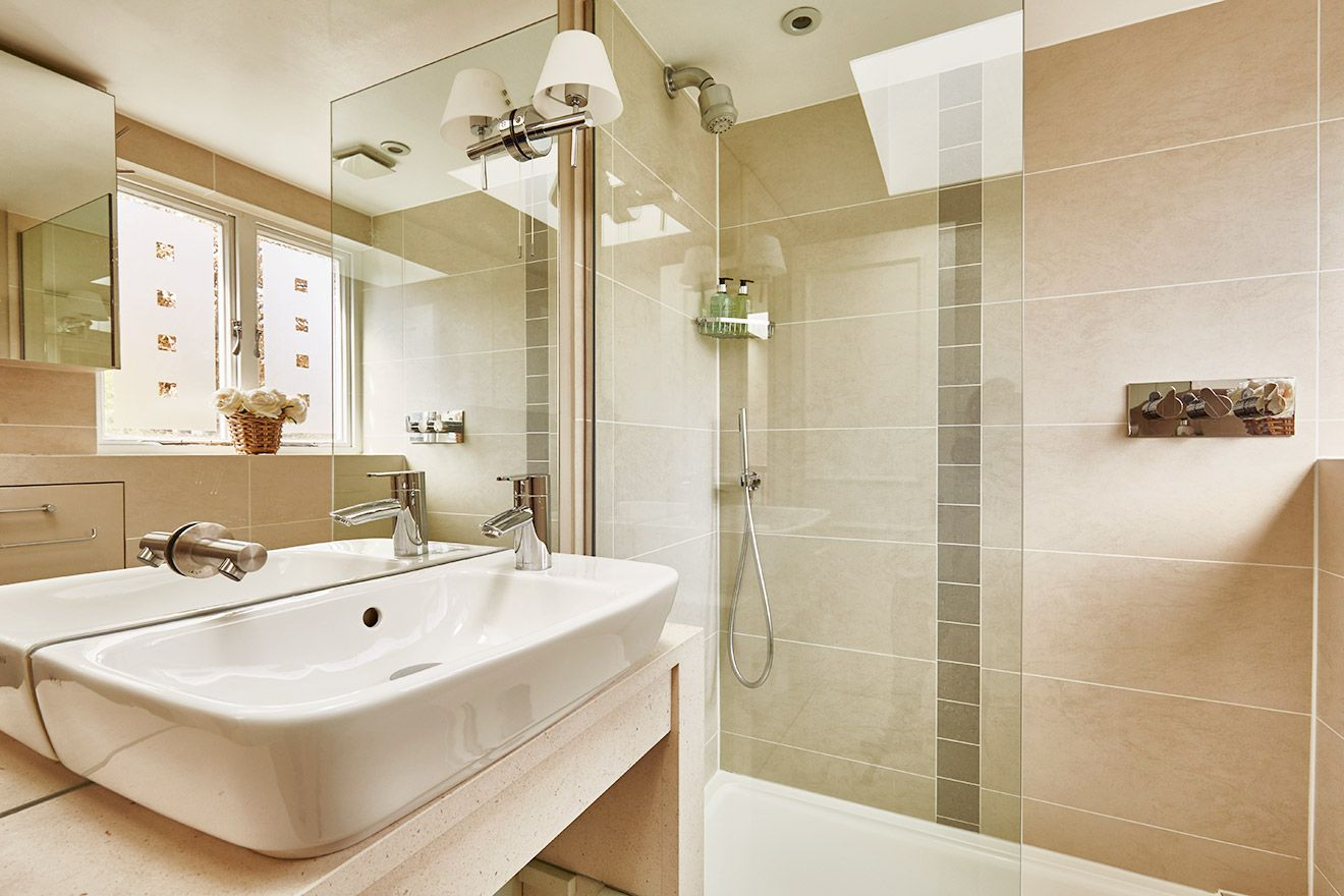 Modern bathroom on the top floor of the Victoria rental offered by London Perfect