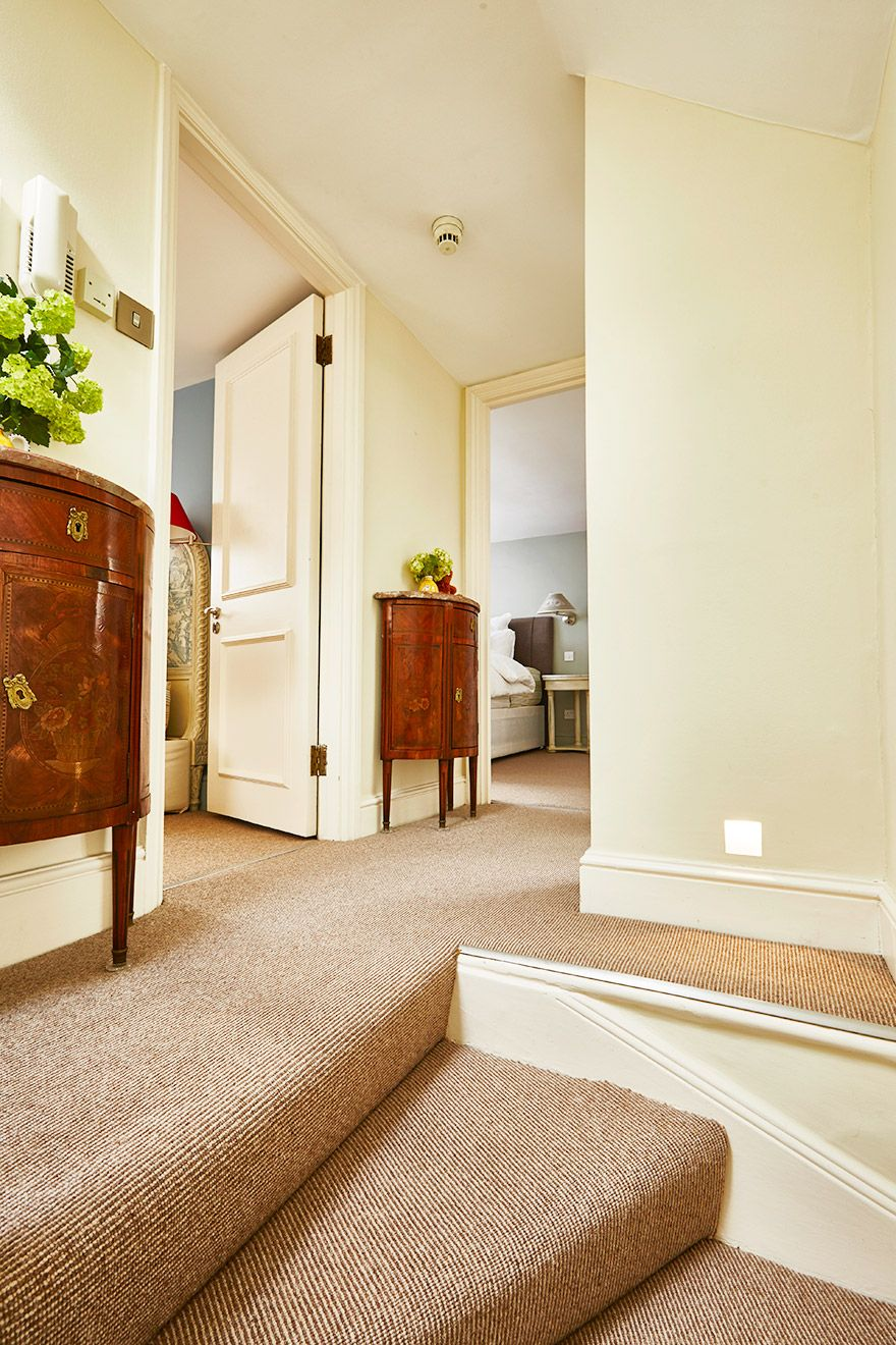 View towards third and fourth bedrooms of the Victoria rental offered by London Perfect
