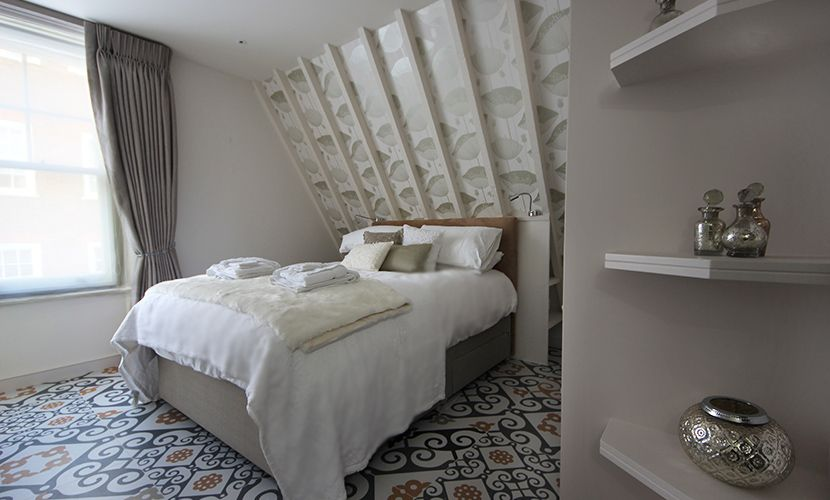 Stylish bedroom with comfortable bed and en suite bathroom