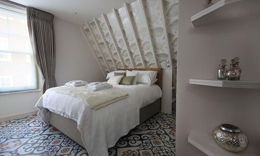 Stylish bedroom with queen bed and en suite bathroom