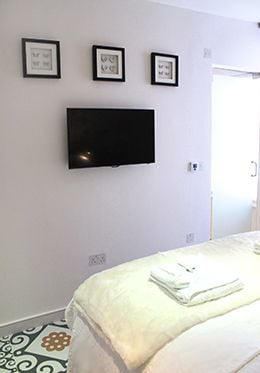 Wall mounted flat screen TV in the bedroom