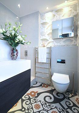 En suite bathroom with heated towel rail and floors